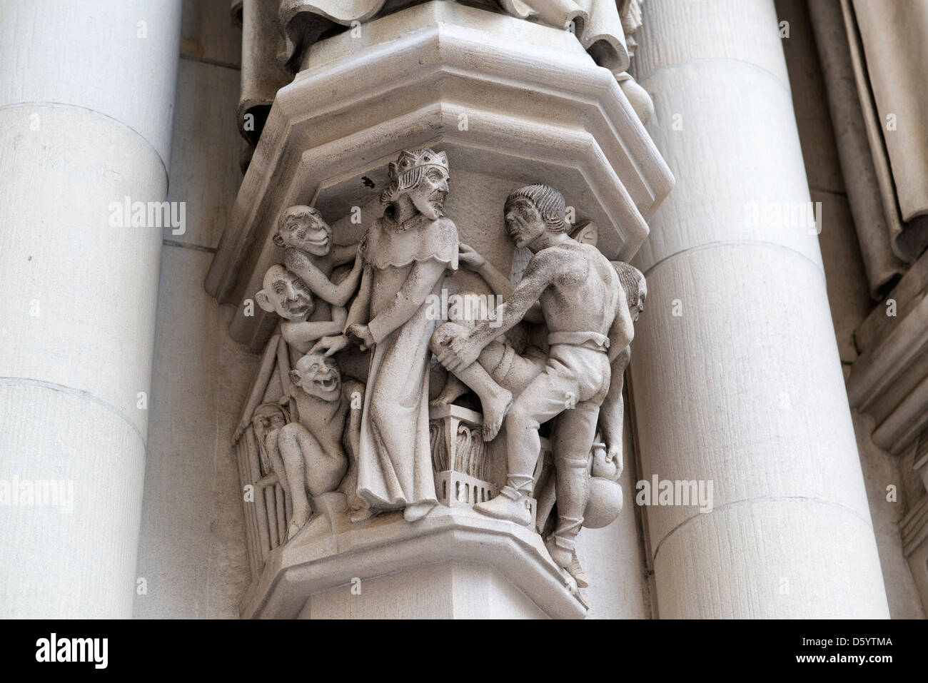 Carvings on the western facade of the Cathedral Church of St John the Divine. - Stock Image
