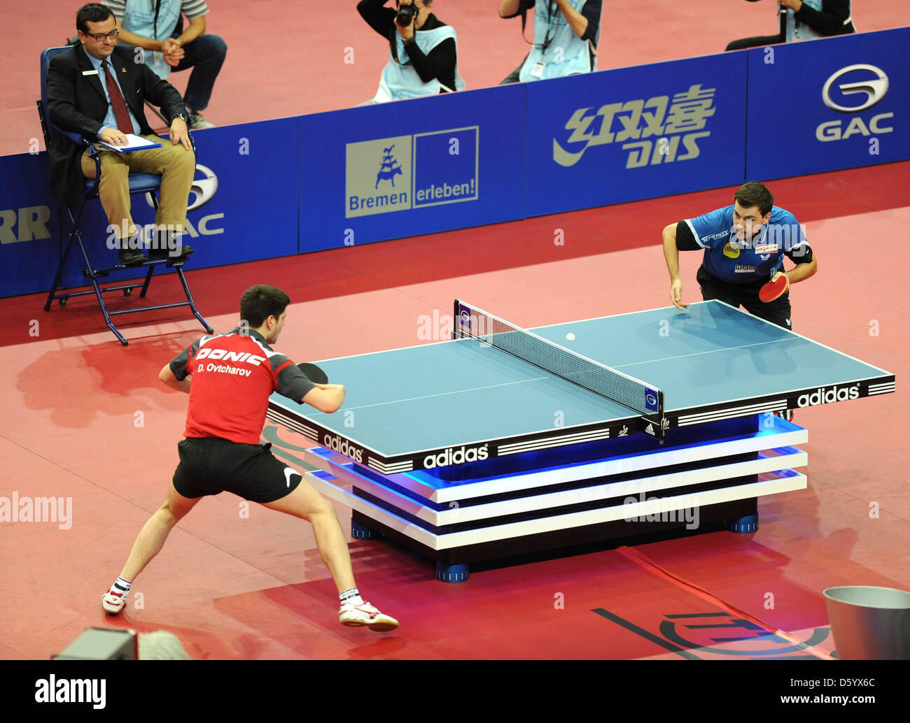 Germans Dimitrji Ovtcharov (L) and Timo Boll during the men's final match of the Table Tennis German Open in - Stock Image
