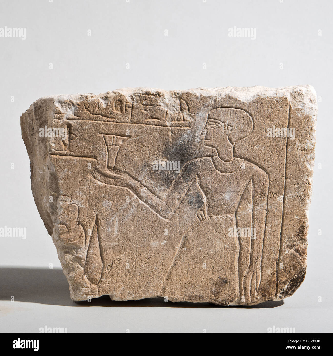 An Egyptian Limestone fragment of a relief 1st millennium BCE - Stock Image