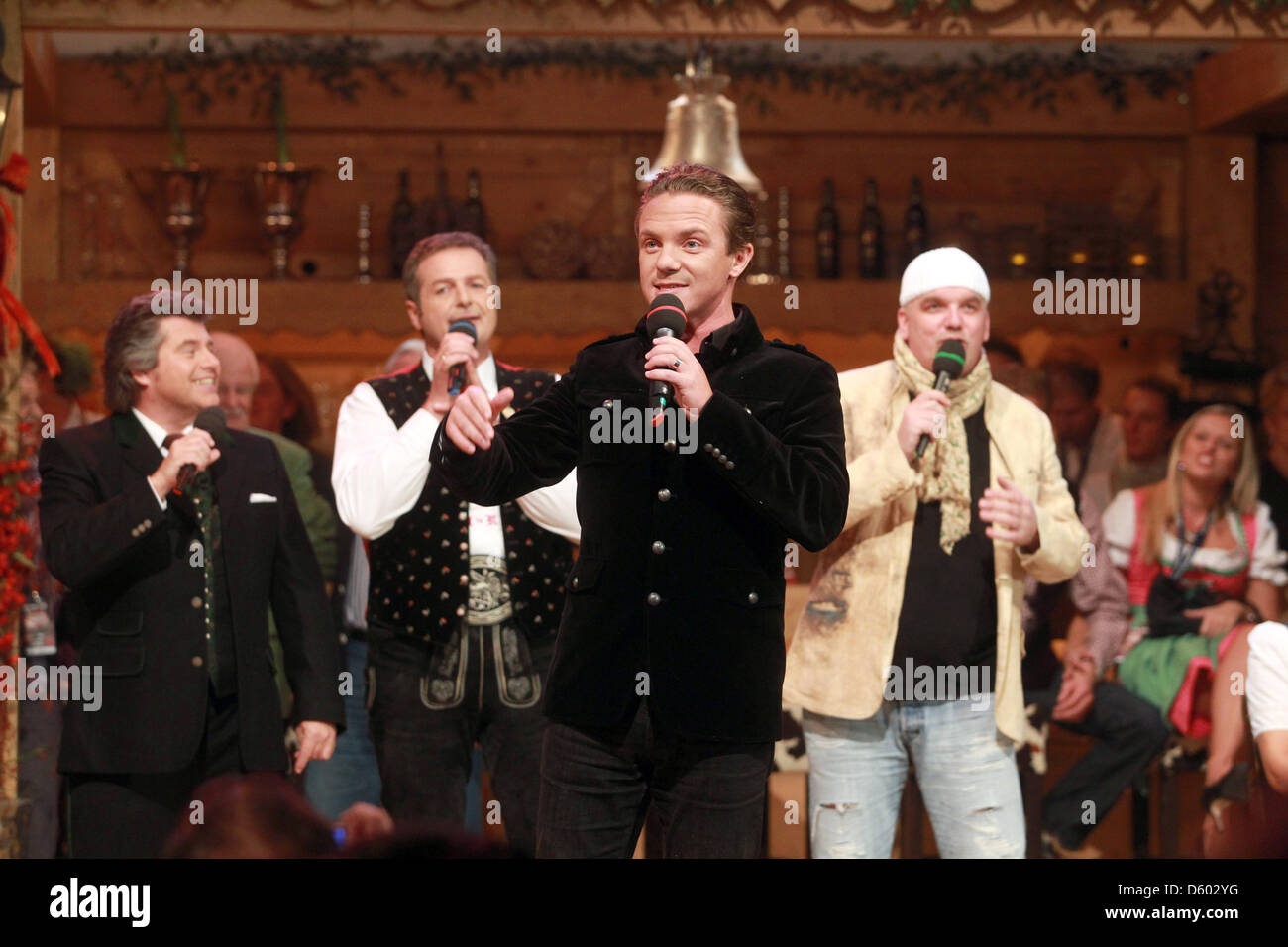 The traditional folk music stars Andy Borg, Norbert Rier, Stefan Mross and DJ Oetzi (l-r)are pictured on stage during - Stock Image