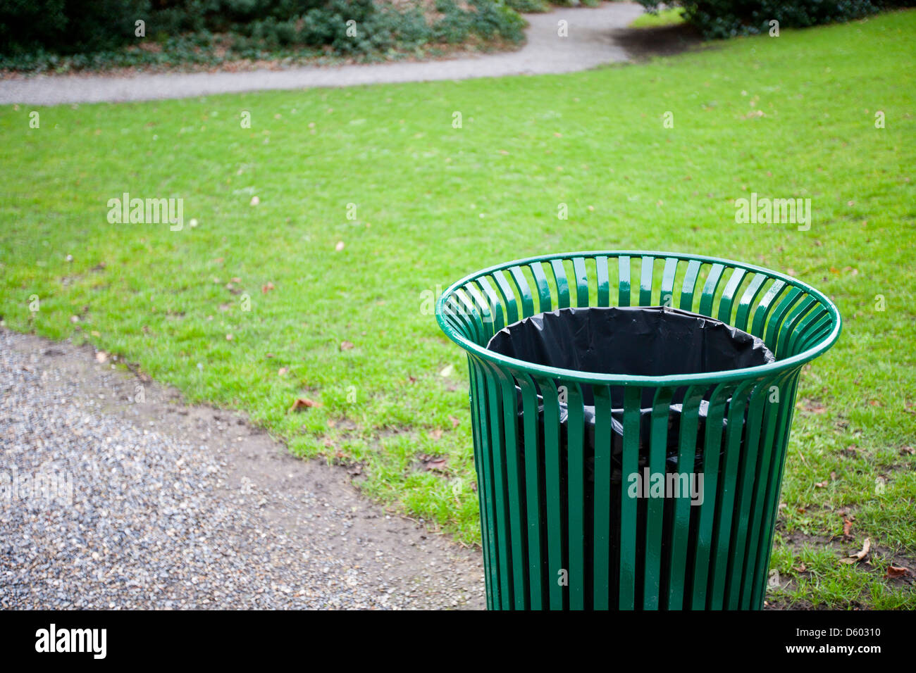Trash can in  park - Stock Image