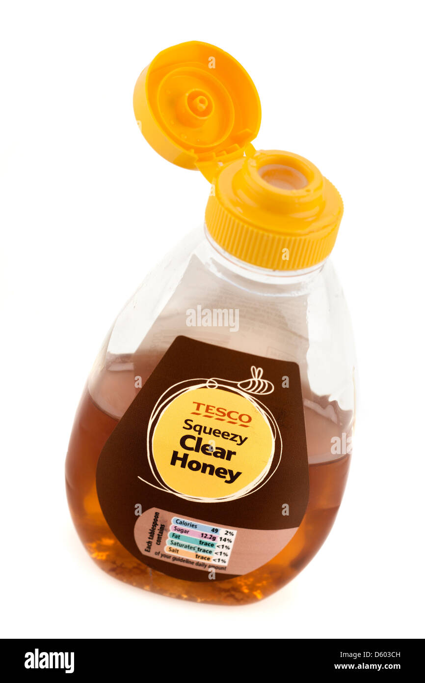 Half used Tesco plastic squeezy clear honey flip top container - Stock Image