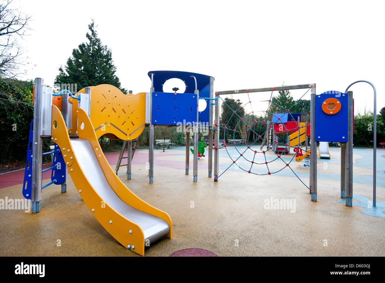 Slide climbing web in children's playground - Stock Image