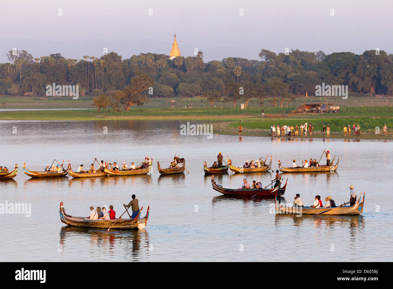 Tourist boats lining up on Taungthaman Lake, Myanmar, to view sunset over U Bein Teak Bridge 2 Stock Photo