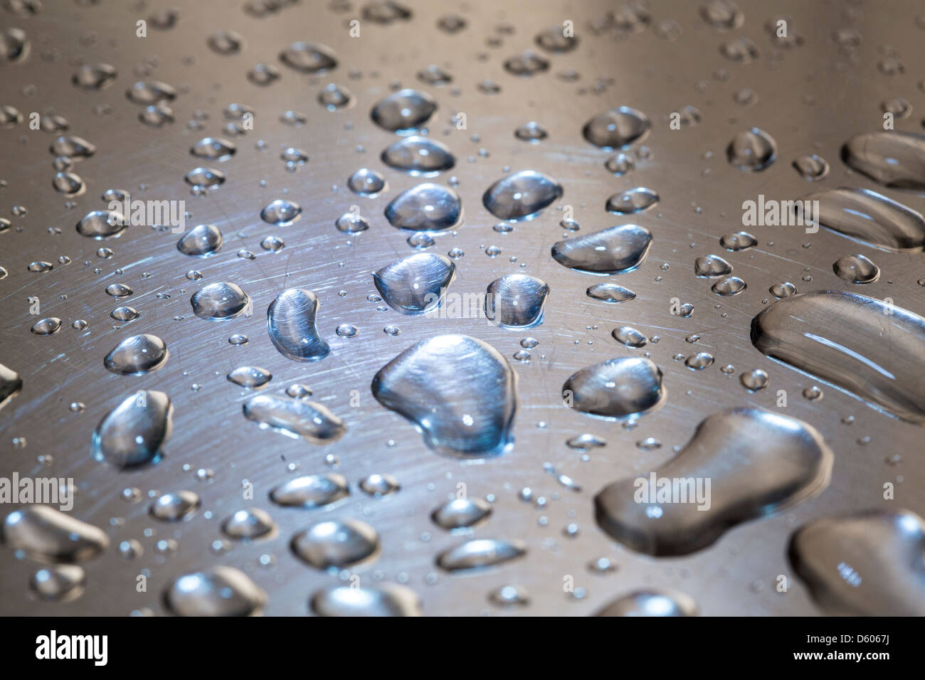 Water drops on a metal surface. Stock Photo
