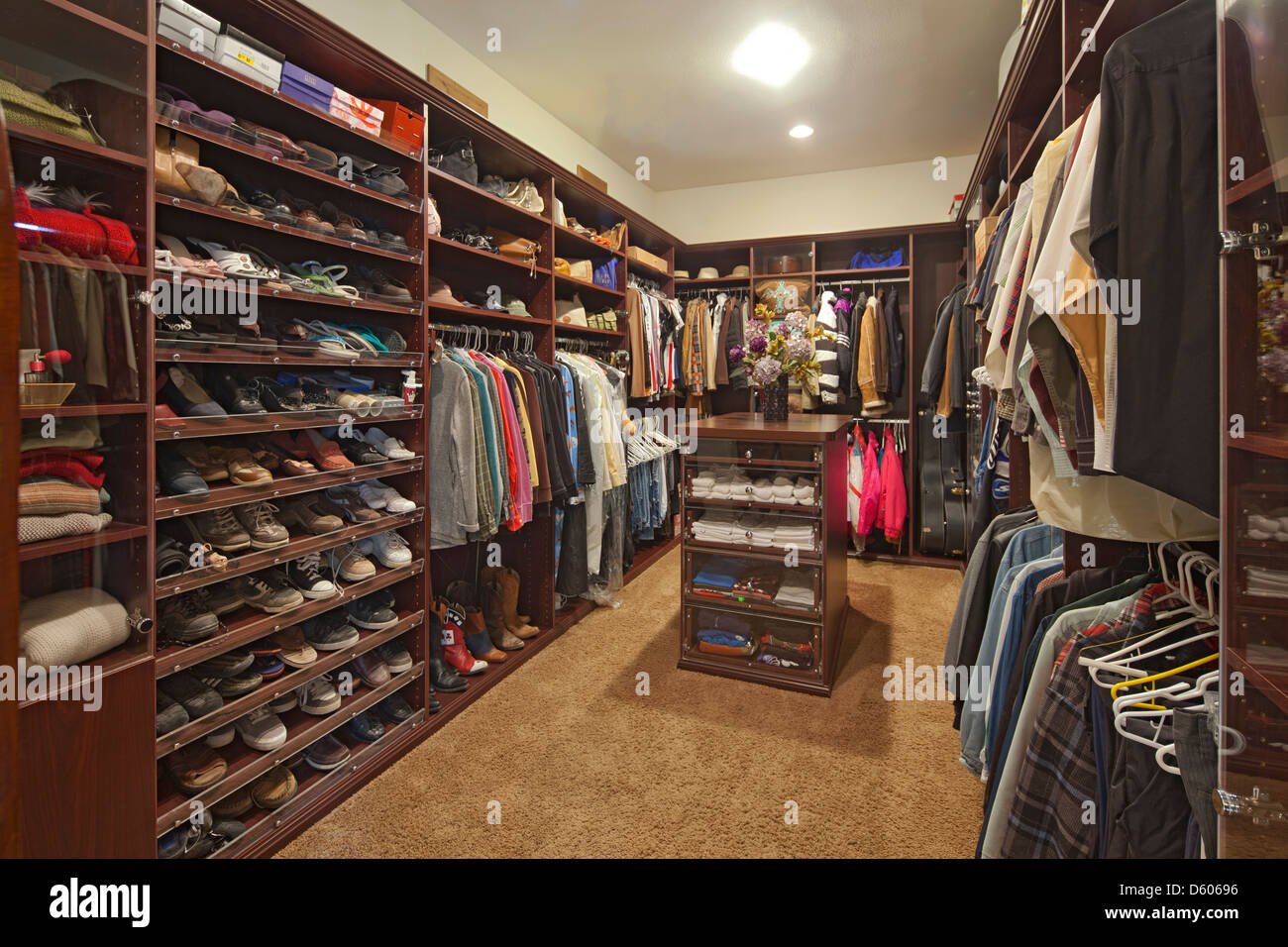 Walk in closet with organized clothing - Stock Image