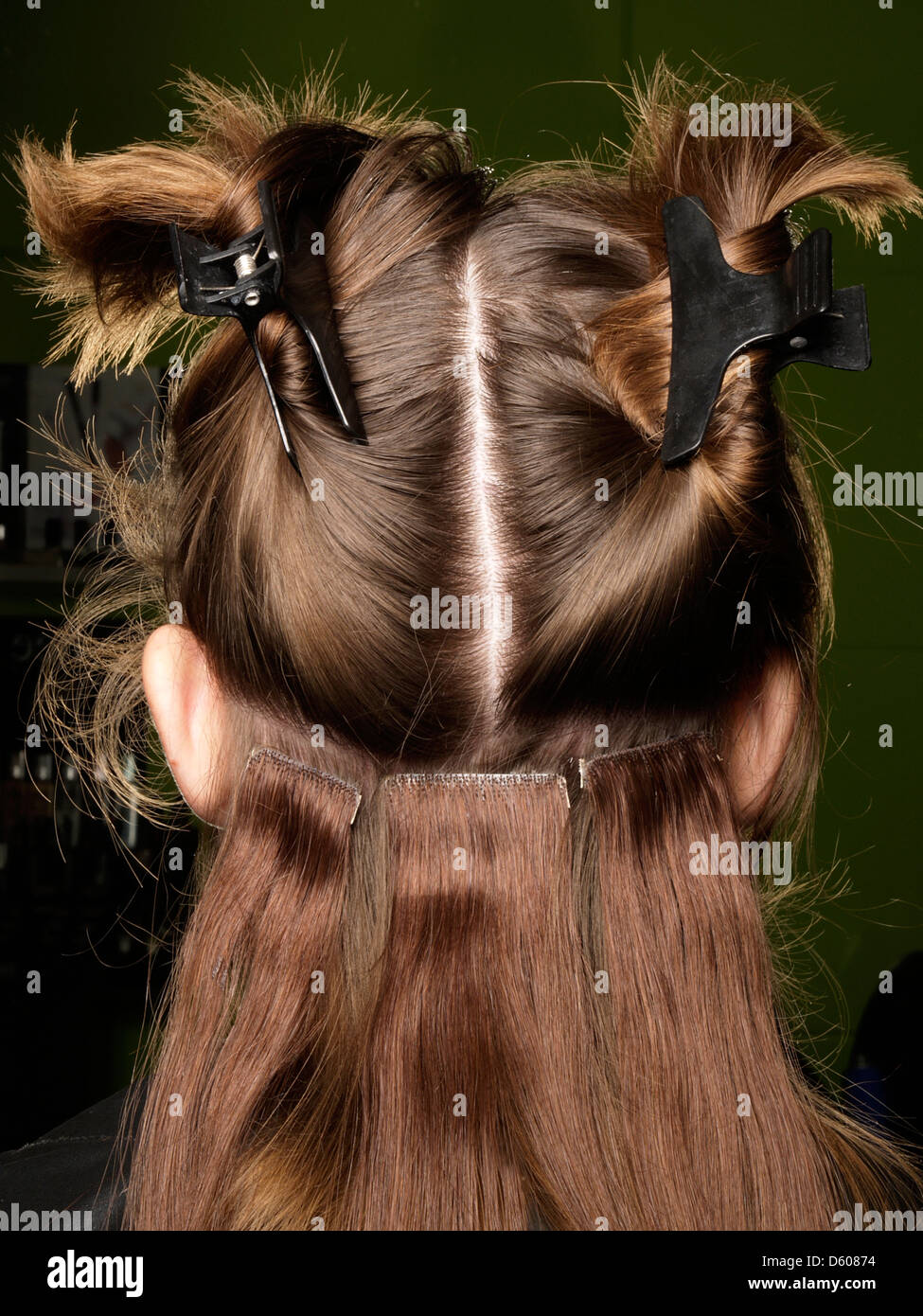 Closeup Of Hair Extensions Being Attached To The Back Of The Head Of