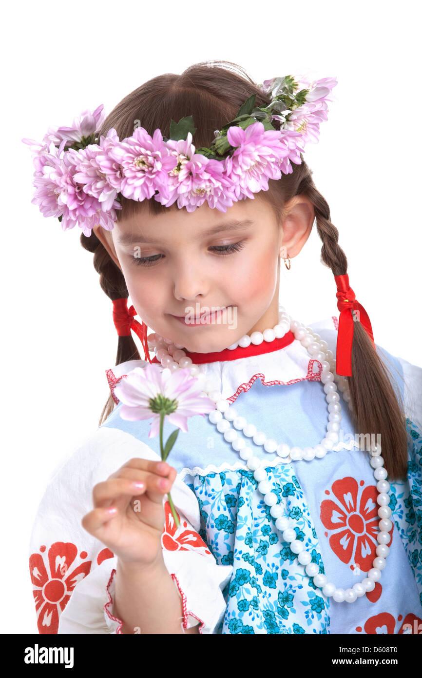 Beautiful girl in slavic costume and garland - Stock Image