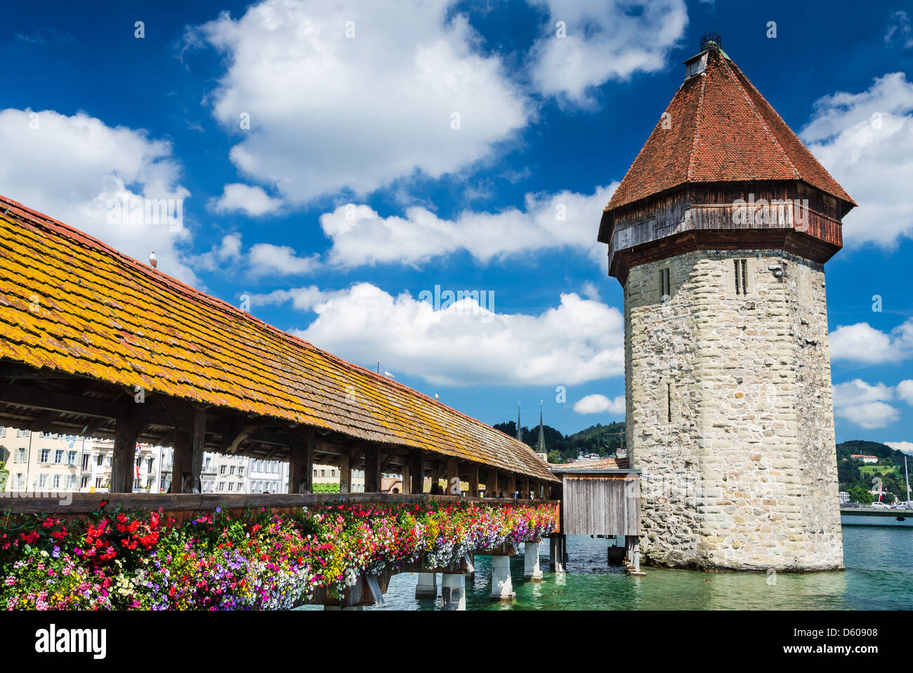 A view of the famous wooden Chapel Bridge of Luzern, Lucerne in Switzerland, with the tower in foreground - Stock Image
