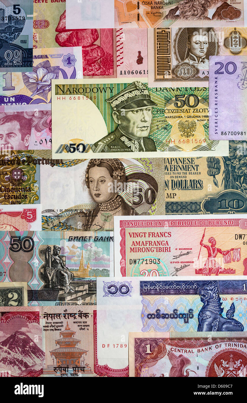 International currency with banknotes from different world countries. - Stock Image