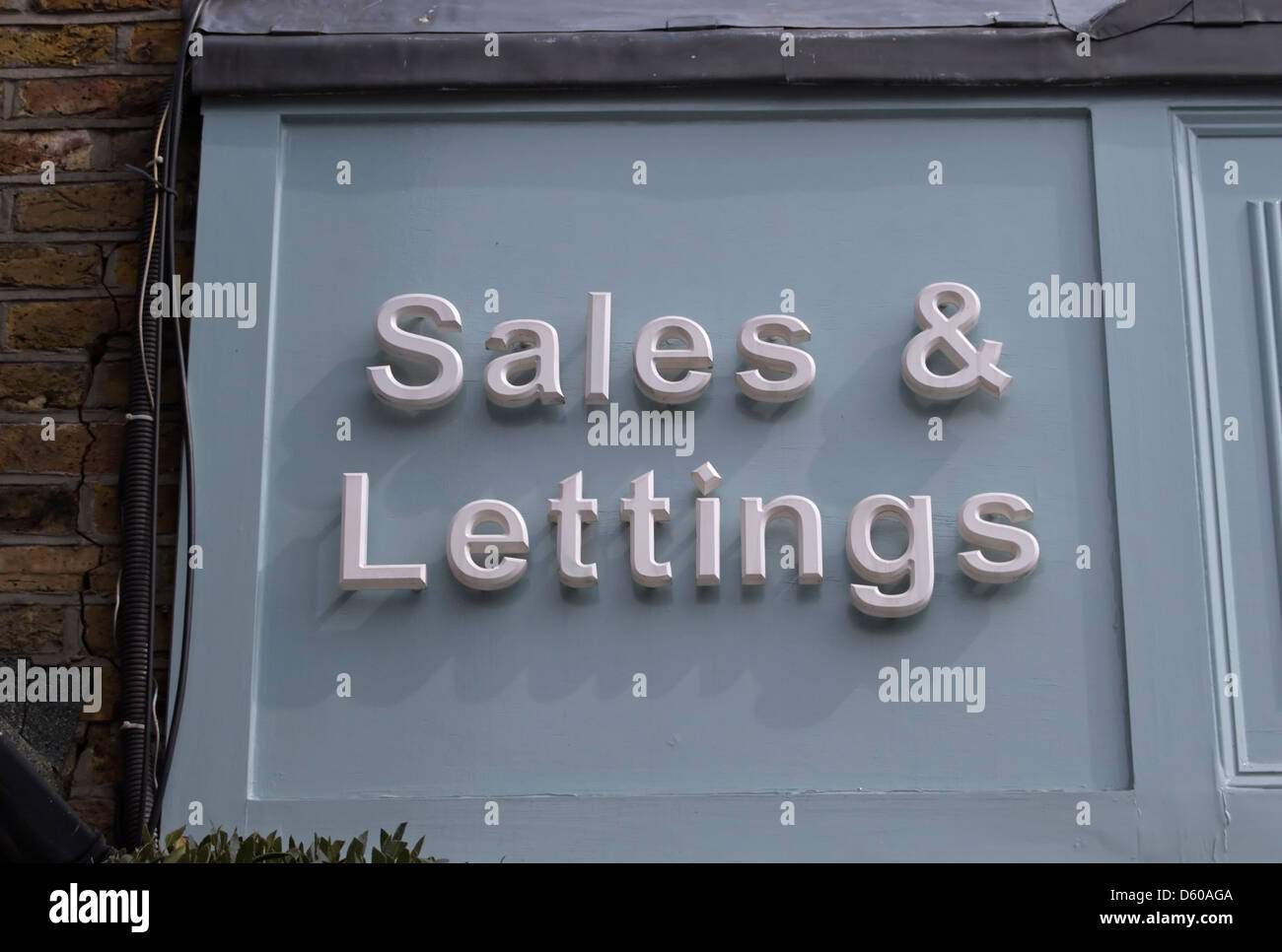 sales and lettings sign outside an estate agents in teddington, middlesex, england - Stock Image