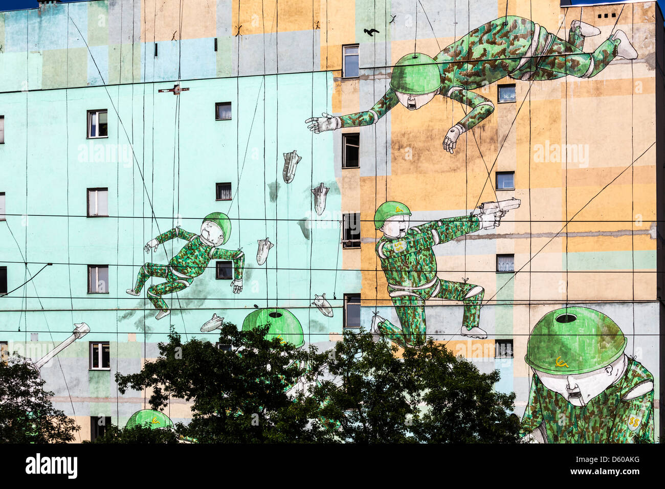 Part of an anti-war mural by Italian artist Blu in Warsaw, Poland. - Stock Image