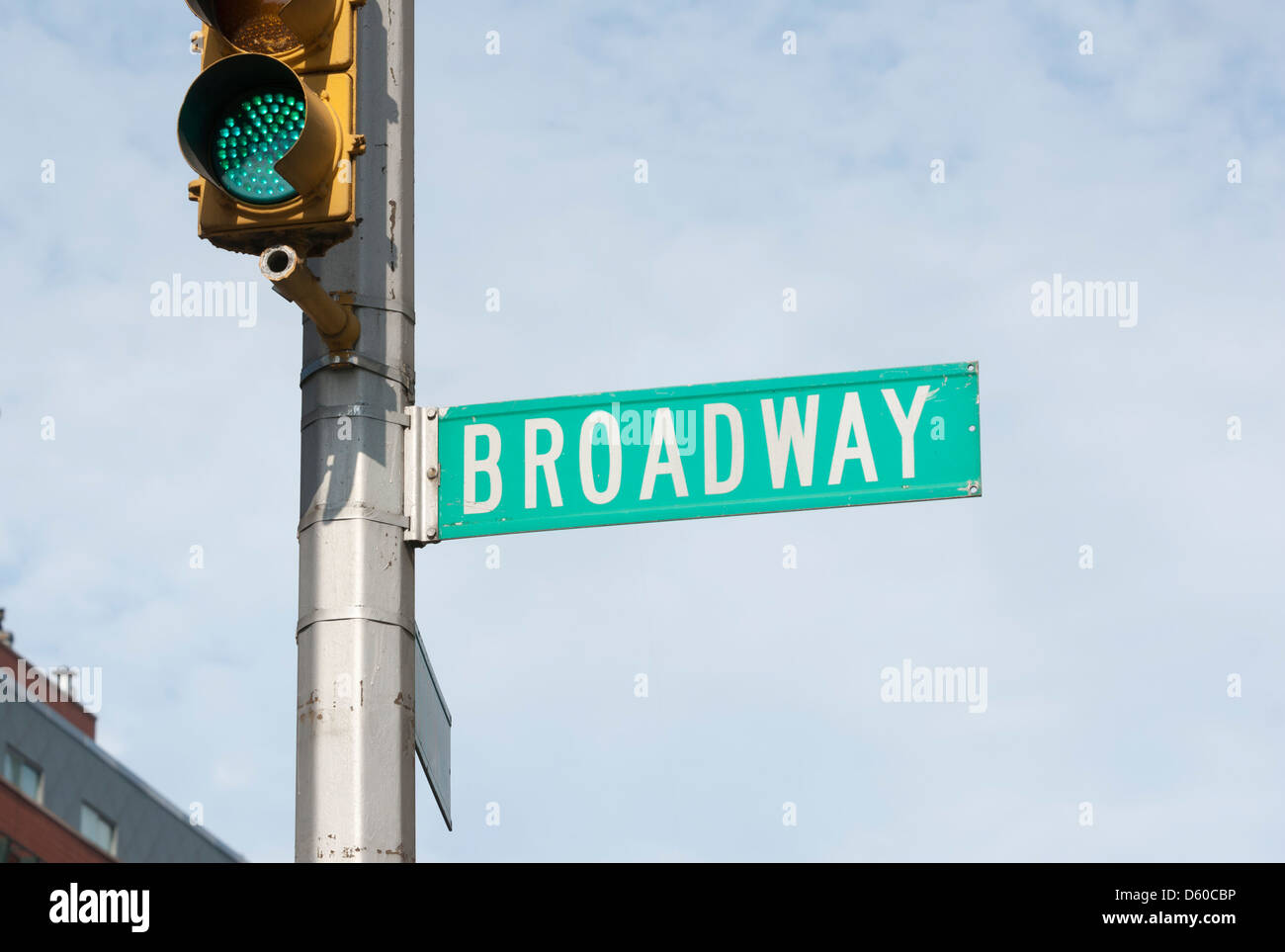 Broadway, street sign with green traffic light in New York City, New York, USA, North America - Image taken from - Stock Image