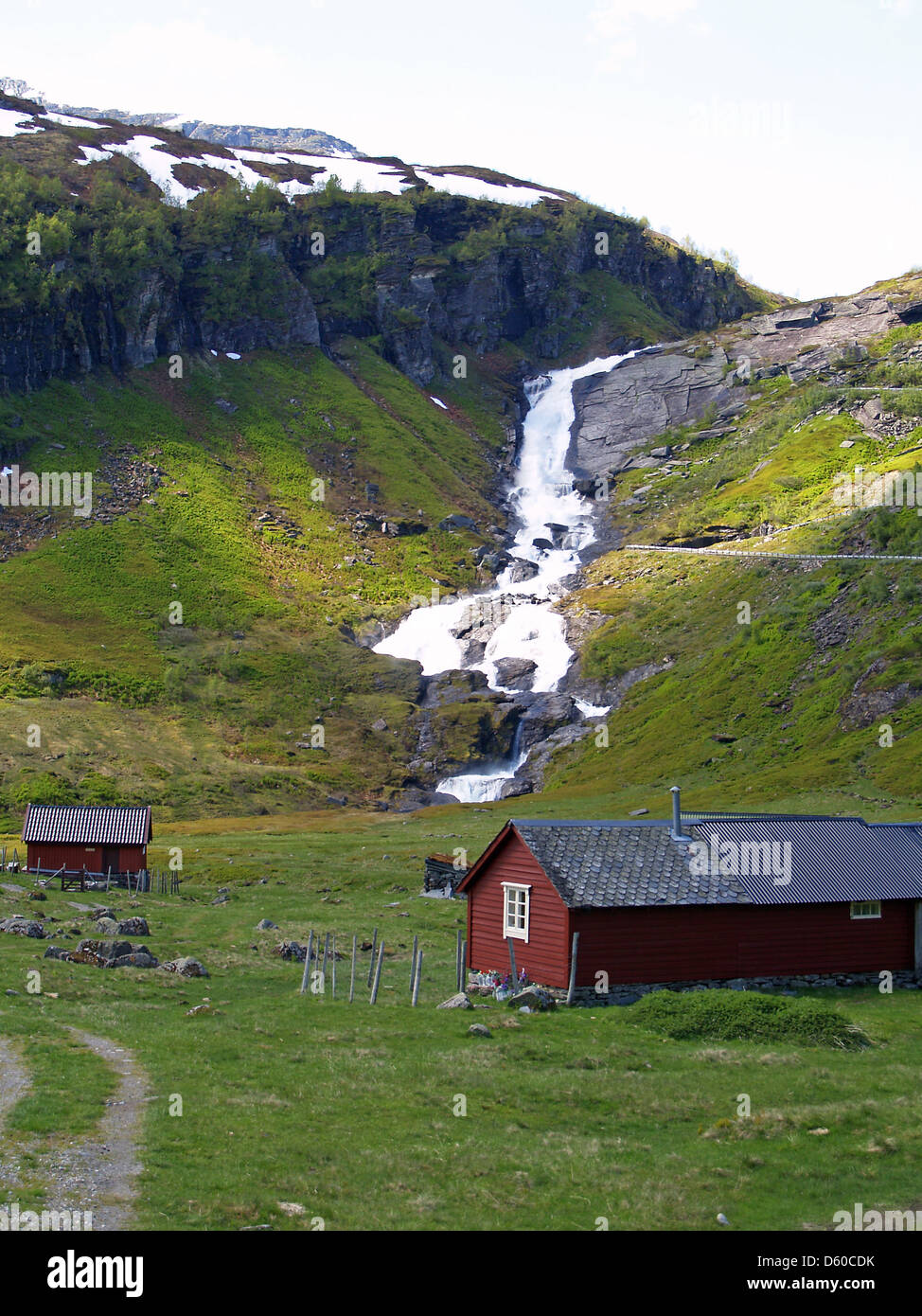 A pastoral scene and waterfall on Highway #13 to Vik,Norway - Stock Image