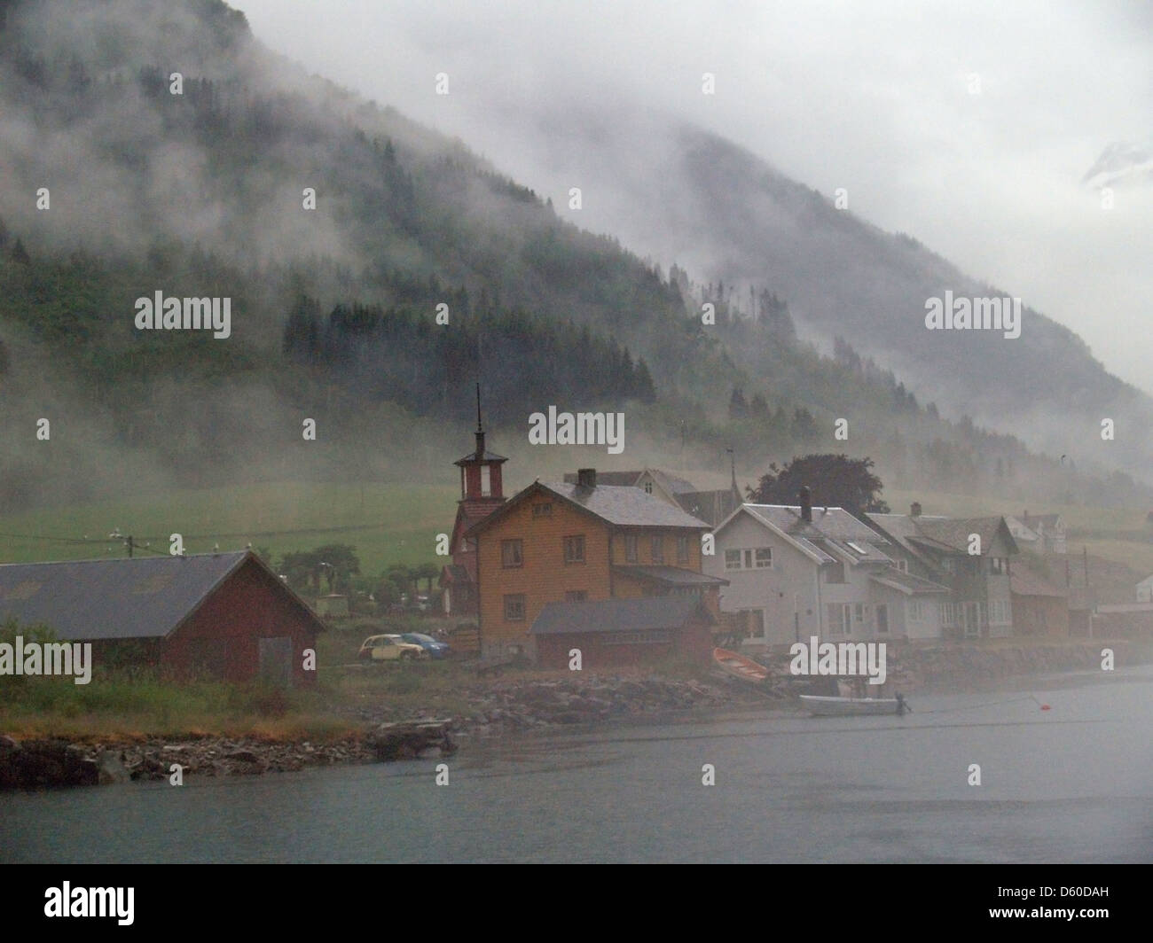 A fog shrouded Fjaerland,Norway - Stock Image