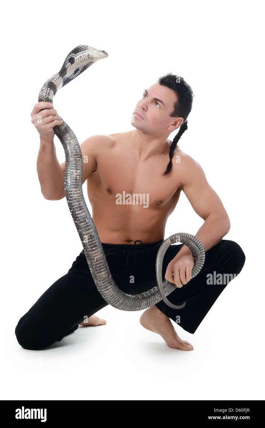 The man the trainer with cobra - Stock Image