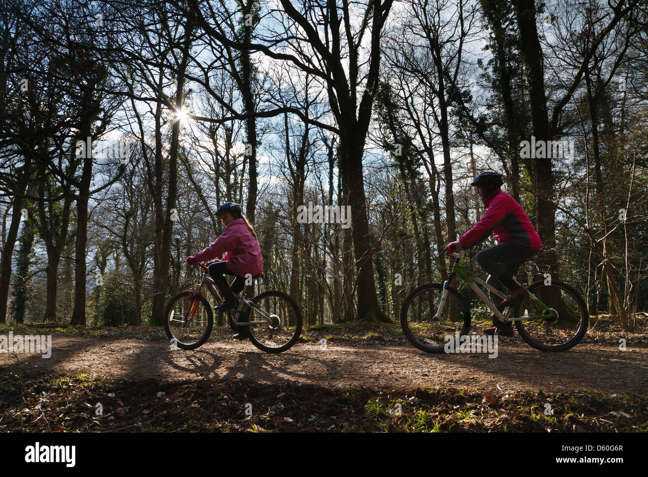 Mother and daughter cycling in the Forest of Dean, Gloucestershire, England Stock Photo
