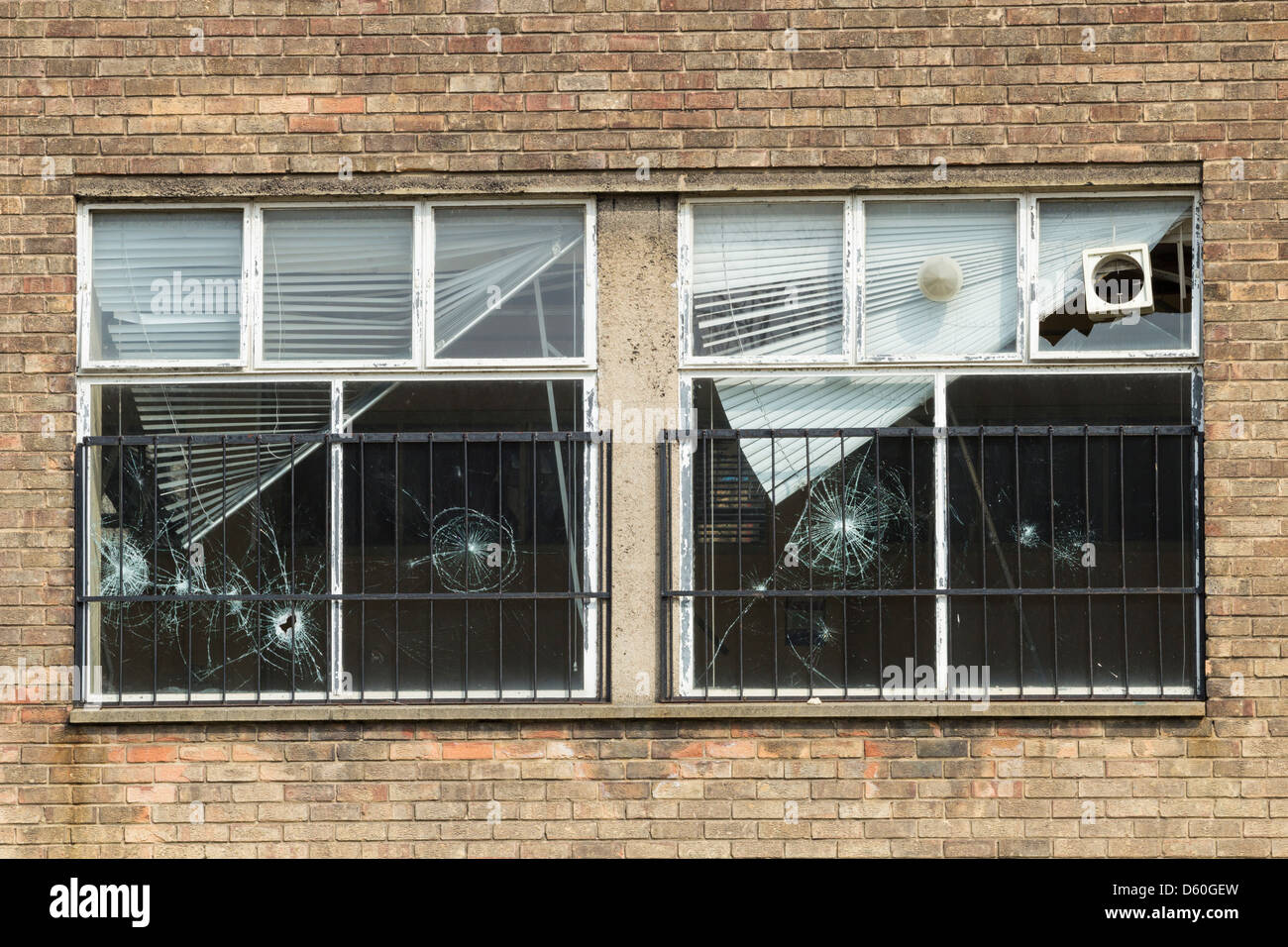 Broken window at derelict school. UK - Stock Image