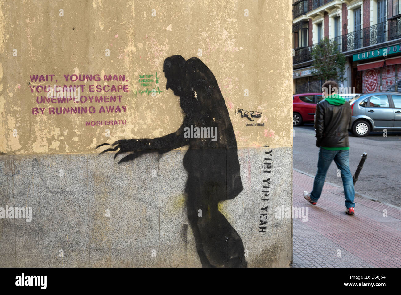 Graffiti about unemployment on a wall in Spain - Stock Image