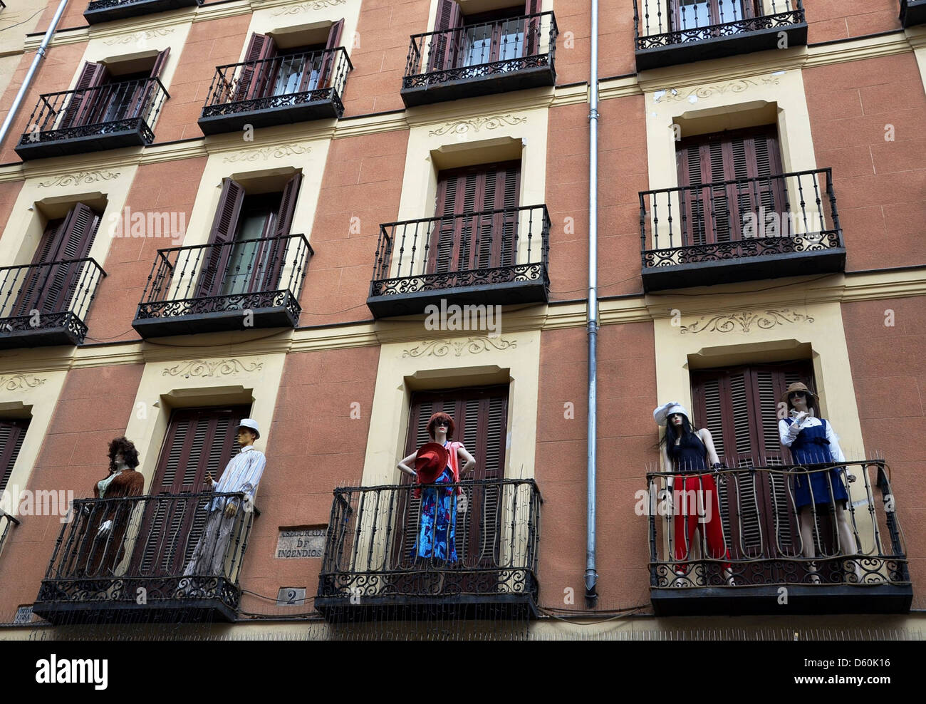 Clothes models at a window in Madrid - Stock Image