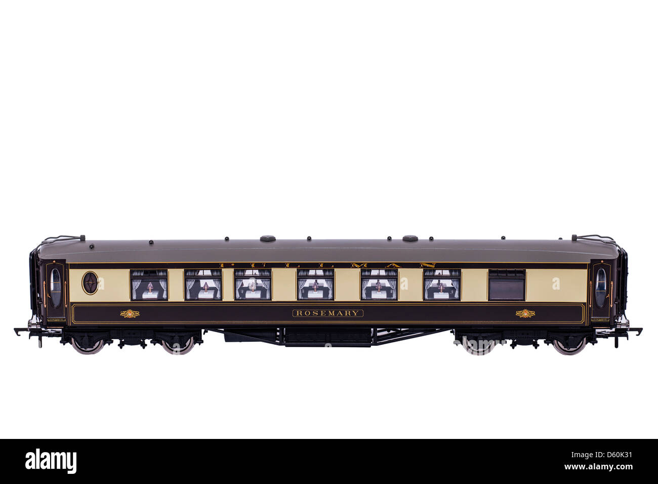 A Hornby model steam train Pullman carriage on a white background - Stock Image