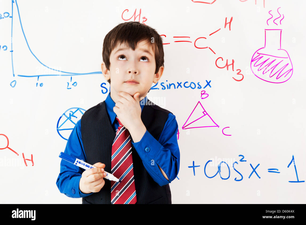 child prodigy in meditations at chalkboard - Stock Image