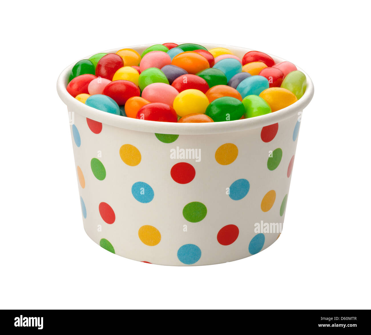 Jellybeans in a paper cup, isolated on white. - Stock Image