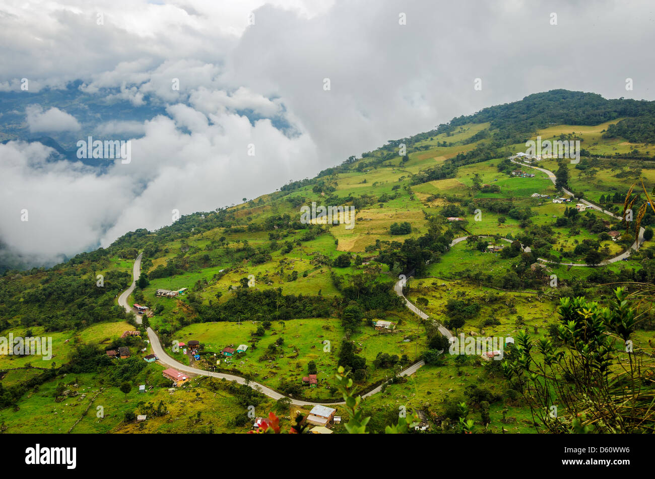 High altitude road winding through a sparsely populated valley - Stock Image