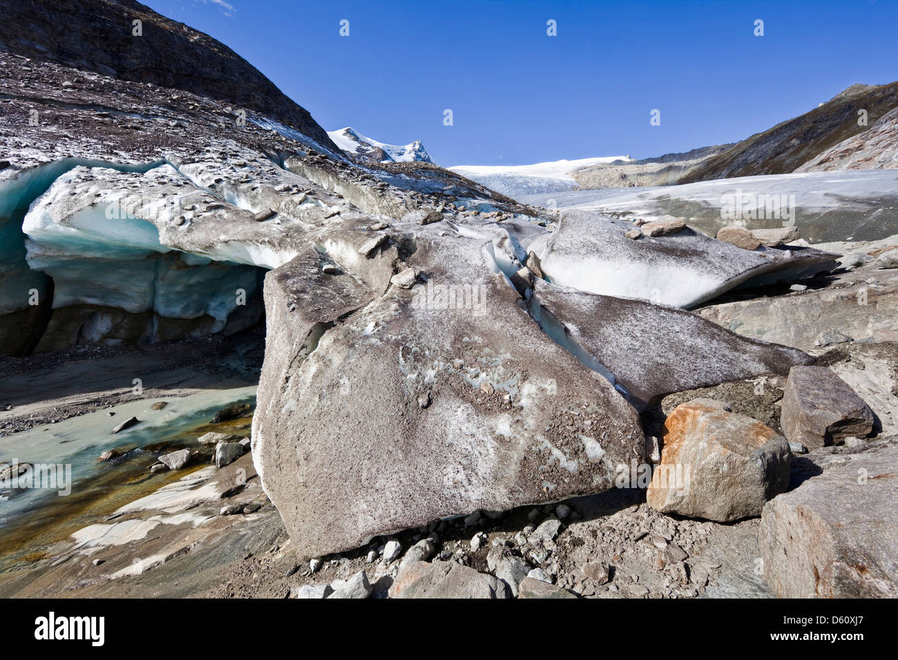 Austria, East Tyrol. Ice cave and glacier snout of Schlatenkees, source of Schlatenbach creek. Ice cave with two - Stock Image