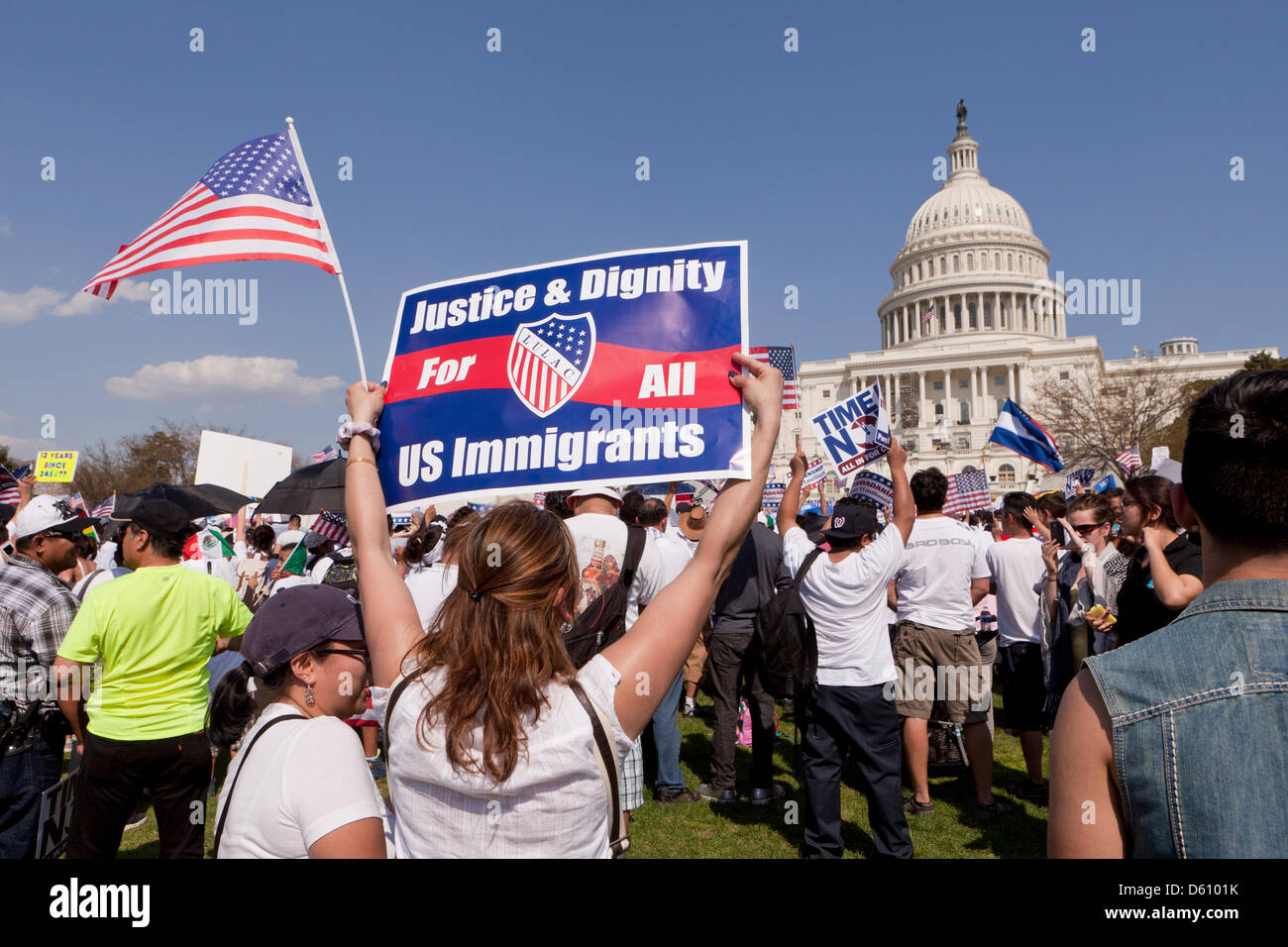 Woman holding a placard at an immigration reform rally in Washington DC - Stock Image