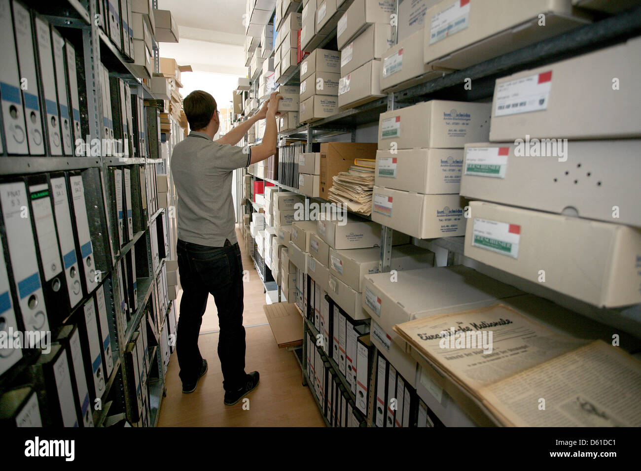 An employee stands between the shelves in the Antifacist Press Archive and Education Center Berlin e.V., apabiz, Stock Photo