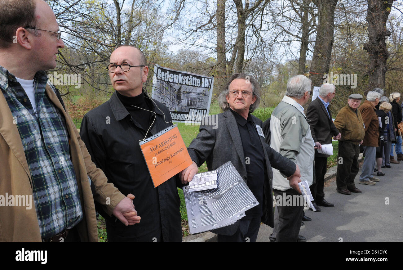 Representatives of victims' associations protest agains the exhibition organization of the KGB Memorial in Potsdam, - Stock Image