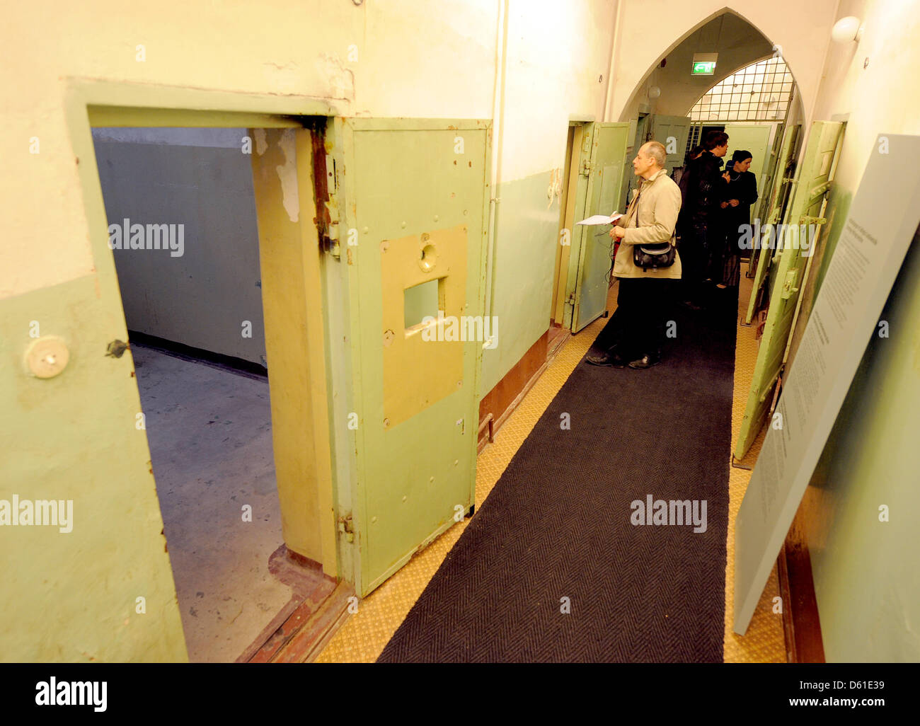 The doors of the cell block are open at the KGB Memorial in Potsdam, Germany, 18 April 2012. The new exhibition - Stock Image