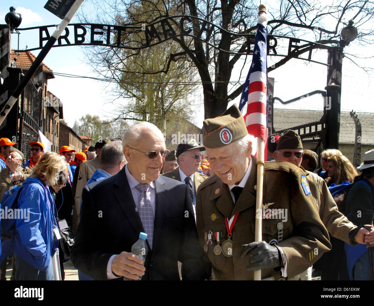 Czech born Holocaust survivor Irving Roth (L) and US veteran Frederick Carrier (R, with US flag) take part in the - Stock Image