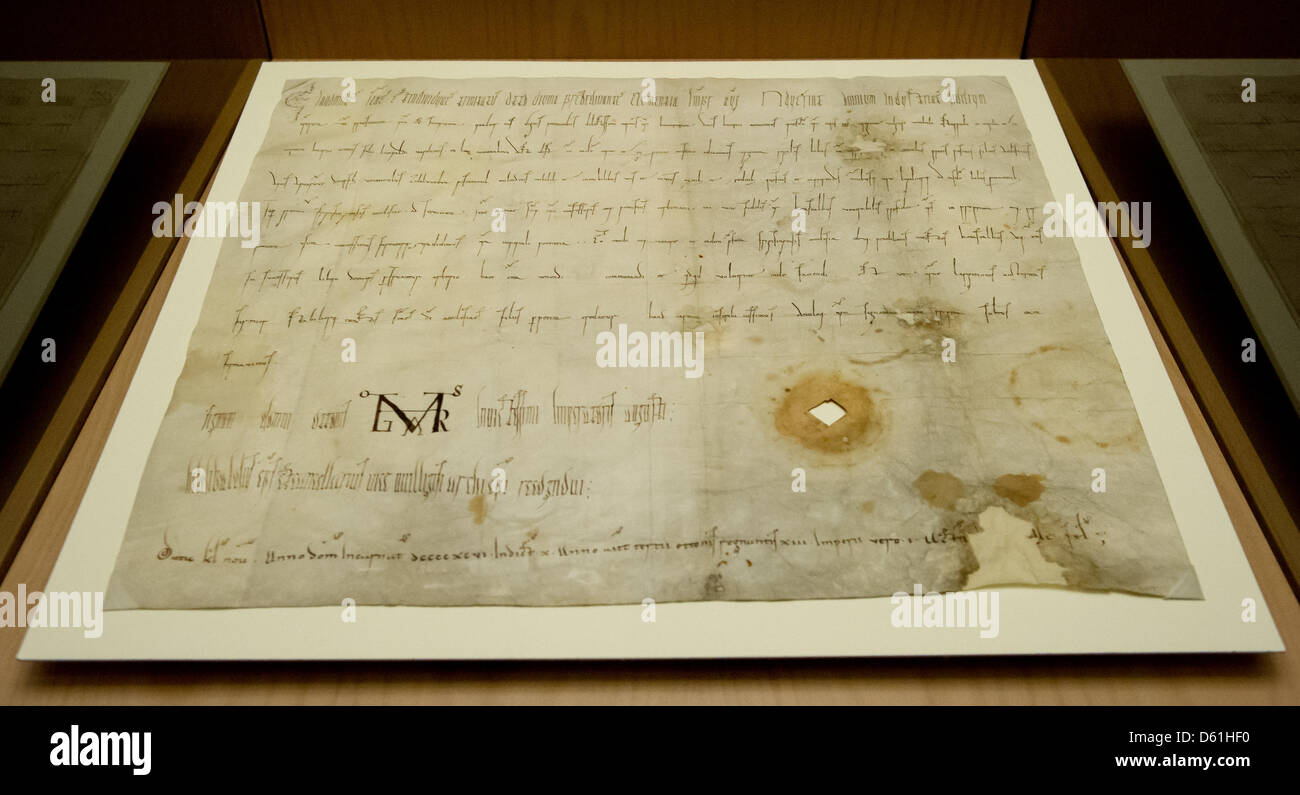 A document from 996 which is called 'birth certificate' and mentions Austria for first time is on display - Stock Image