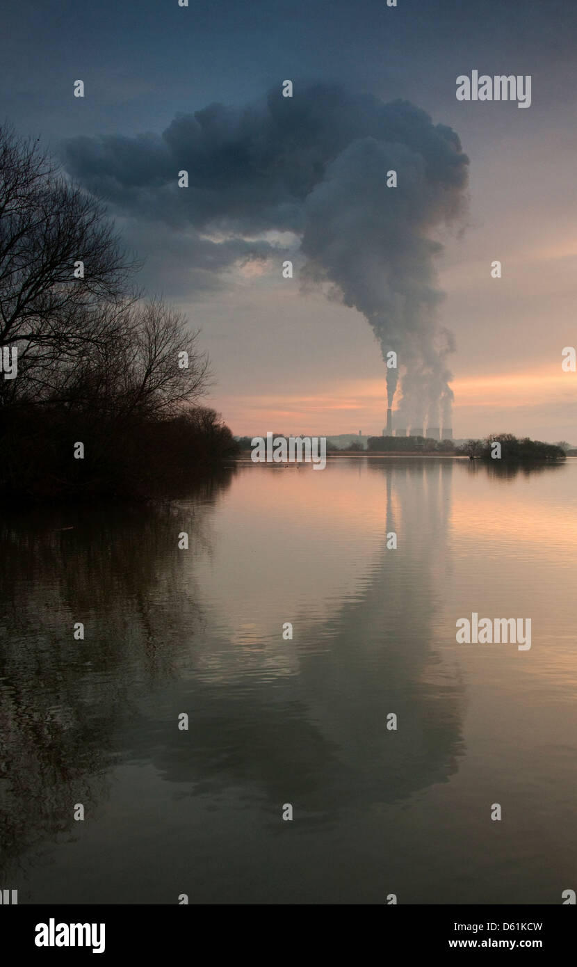 Ratcliffe on Soar power station reflected in the water at Attenborough Nature Reserve in Nottinghamshire England - Stock Image