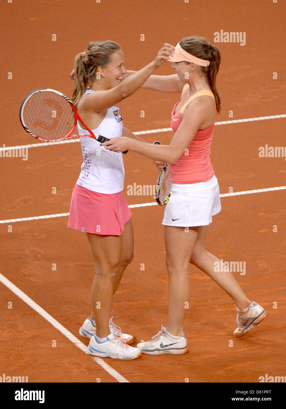 Iveta Benesova (R-L) and Barbora Zahlavova Strycova of the Czech Republic cheer after winning the final match against - Stock Image