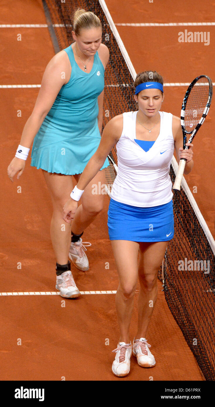 Germany's Anna-Lena Groenefeld (L) und Julia Goerges leave the court after being beaten by Iveta Benesova (R - Stock Image