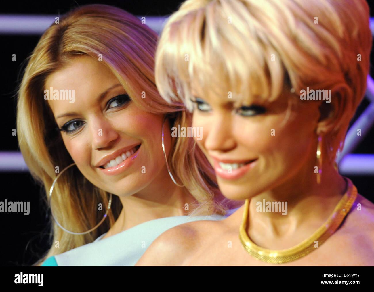 TVpersonality and model Sylvie van der Vaart (L) presents her wax likeness at Madame Tussaud's in Berlin, - Stock Image