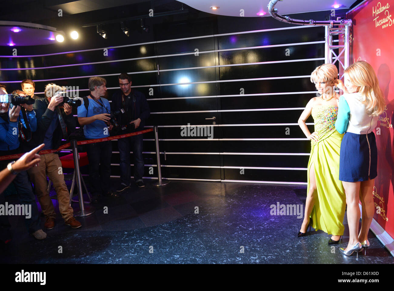 TVpersonality and model Sylvie van der Vaart (R) presents her wax likeness at Madame Tussaud's in Berlin, - Stock Image