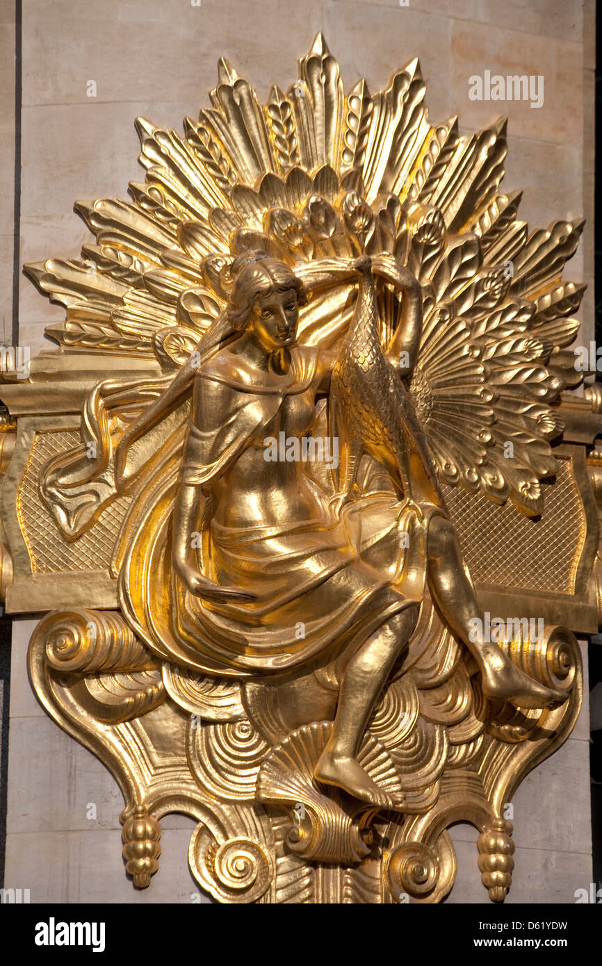 Golden statuary decorates the downtown Commerz Bank in Leipzig, Germany - Stock Image
