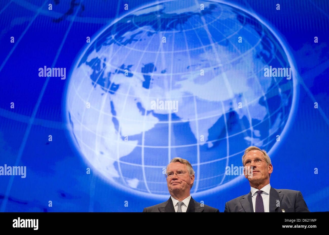 Chairman of the board of Allianz SE Henning Schulte-Noelle (L) and CEO od ALiianz SE Michael Diekmann stand in front of an animated picture of the globe at the general meeting of shareholders at the Olympic Hall in Munich, Germany, 09 May 2012. After a rather bad last year, Allianz can report a good start for 2012. Photo: PETER KNEFFEL Stock Photo