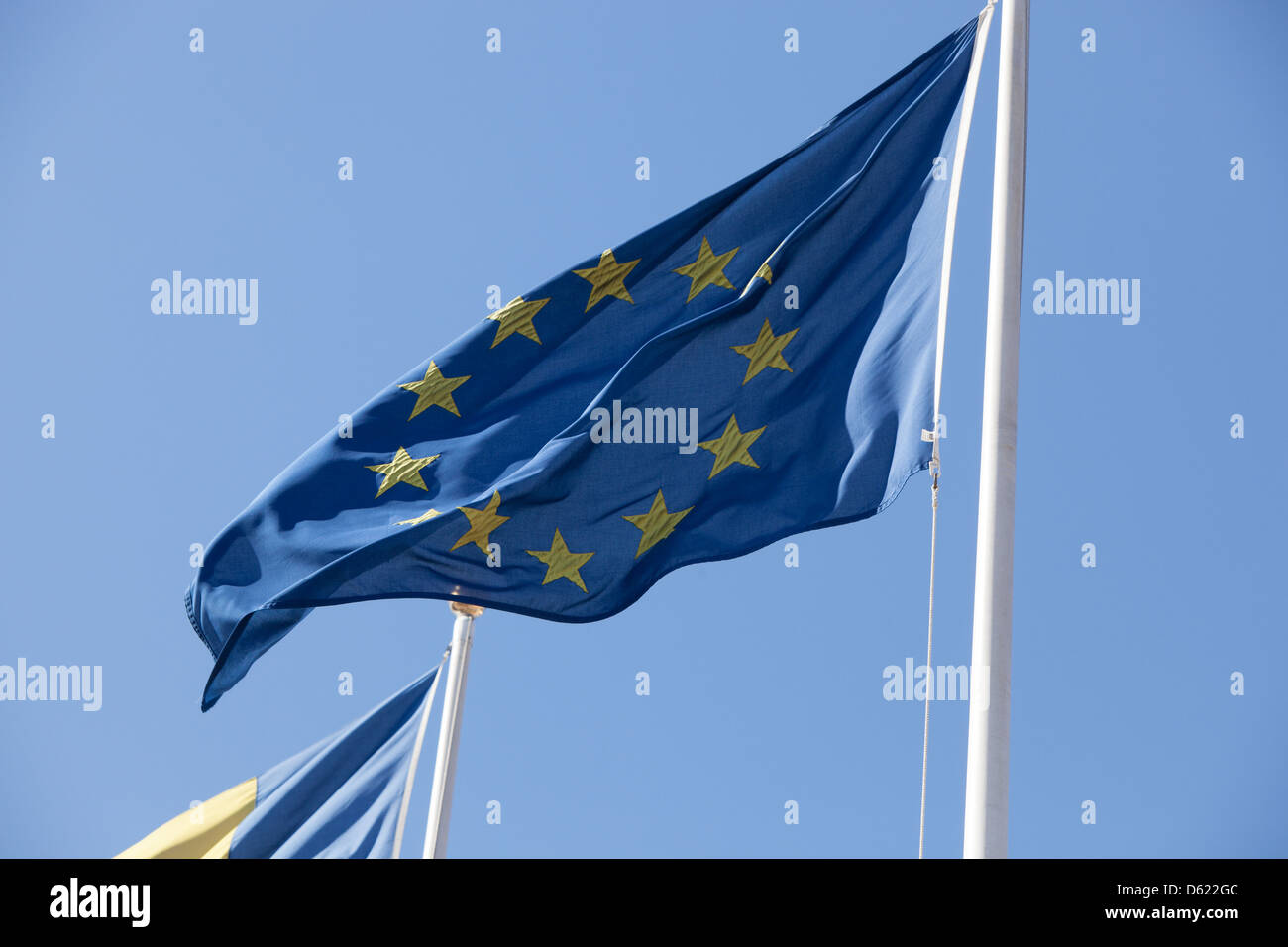 European Union flag fluttering in the breeze. - Stock Image