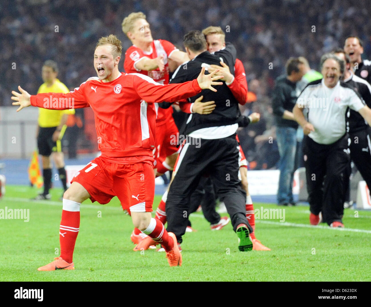 Duesseldorf's players, led by Maximilian Beister (L) cheer the 1-2 ownb goal by Hertha during the first leg - Stock Image
