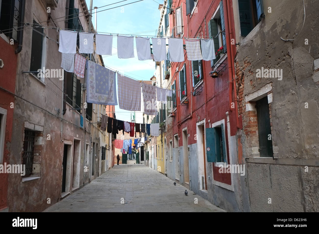Washing hung out between apartments in Arsenale district of Venice, Italy - Stock Image