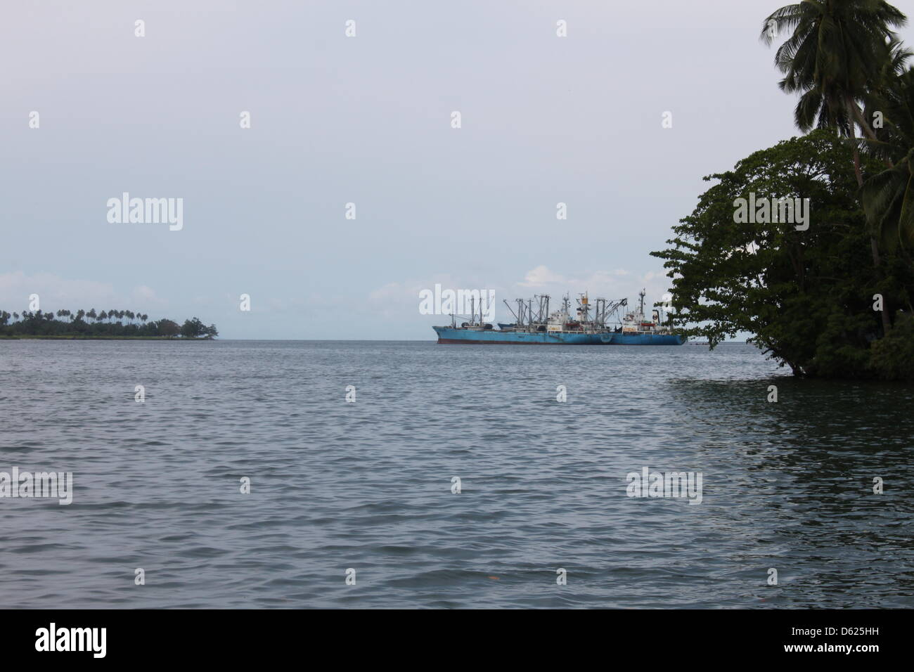 (dpa-file) - A file picture dated 12 October 2011 shows a large ship situated at a bay near Bomlom, Papua New Guinea. - Stock Image