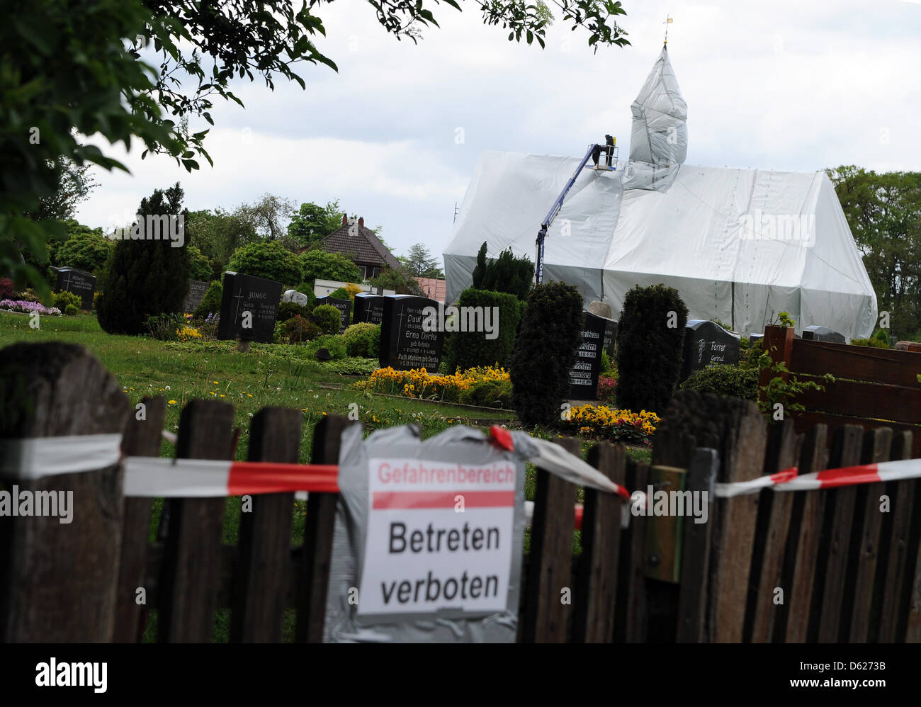 The Saint Nikolaus Chapel is covered with a white foil in Wittorf, Germany, 12 May 2012. The chapel was veiled due - Stock Image