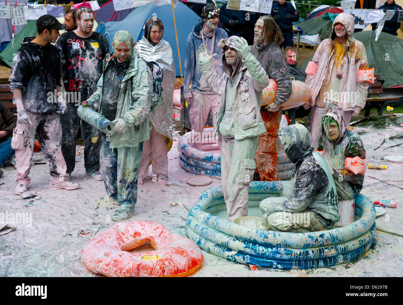 Drenched in wall paint, Occupy activists wait to be cleared out by the police in front of the European Central Bank - Stock Image