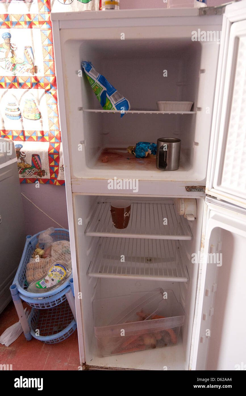 Spoiled food in an unhygienic fridge - Stock Image