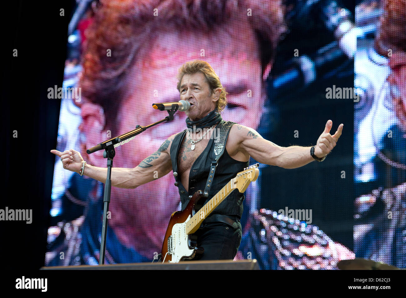German musician Peter Maffay performs with his band on his 'Es wird Sommer Tour 2012' (lit. Summer is coming - Stock Image